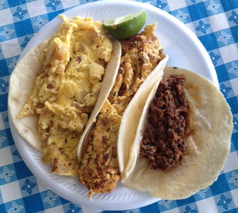 Potato & egg, bacon & egg and barbacoa de chive tacos at La Fruta Feliz.
