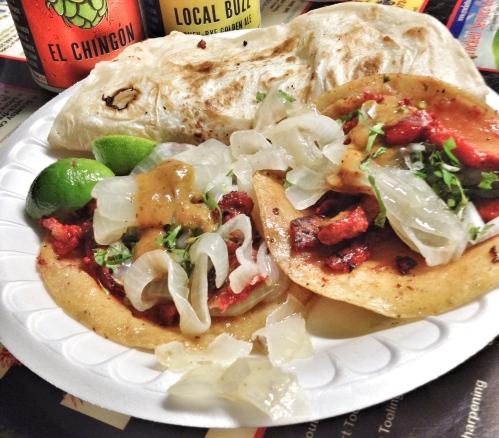 Tacos de trompo and a gringa at Dos Primos Tacos.