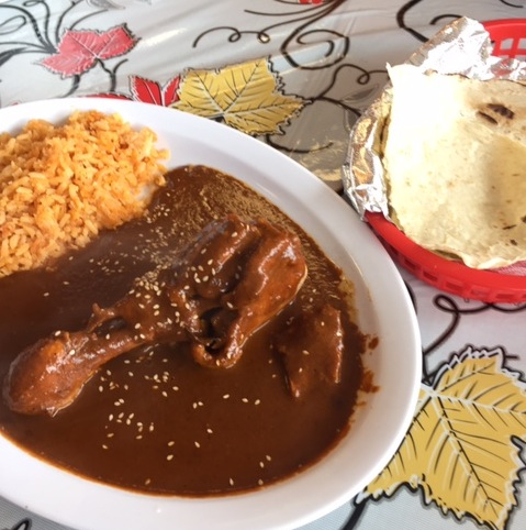 From-scratch mole con pollo is a weekend special at Mi Lindo Oaxaca.